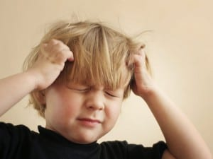 A four year old boy scratching his head Please see some similar images from my portfolio :